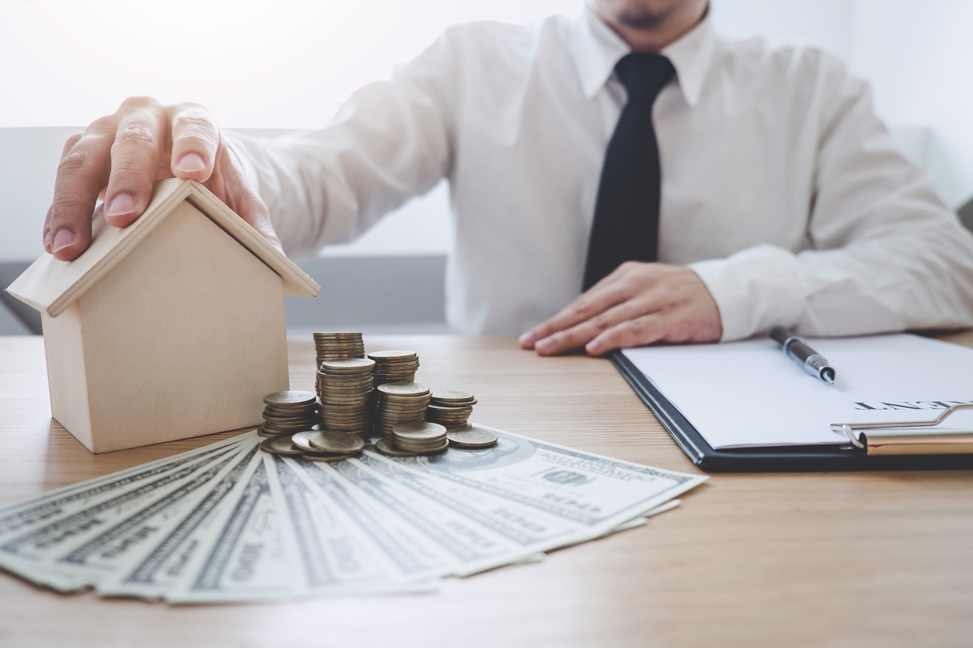 Business Financing Accounting Banking Concept, businessman doing finances and calculate about cost to real estate investment, Concept mortgage loan approval