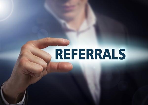 Businessman presses button referrals on virtual screens