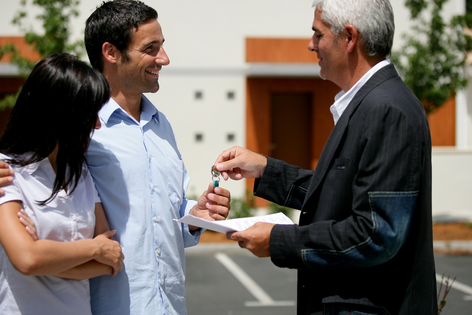 Couple receiving the keys to their new apartment