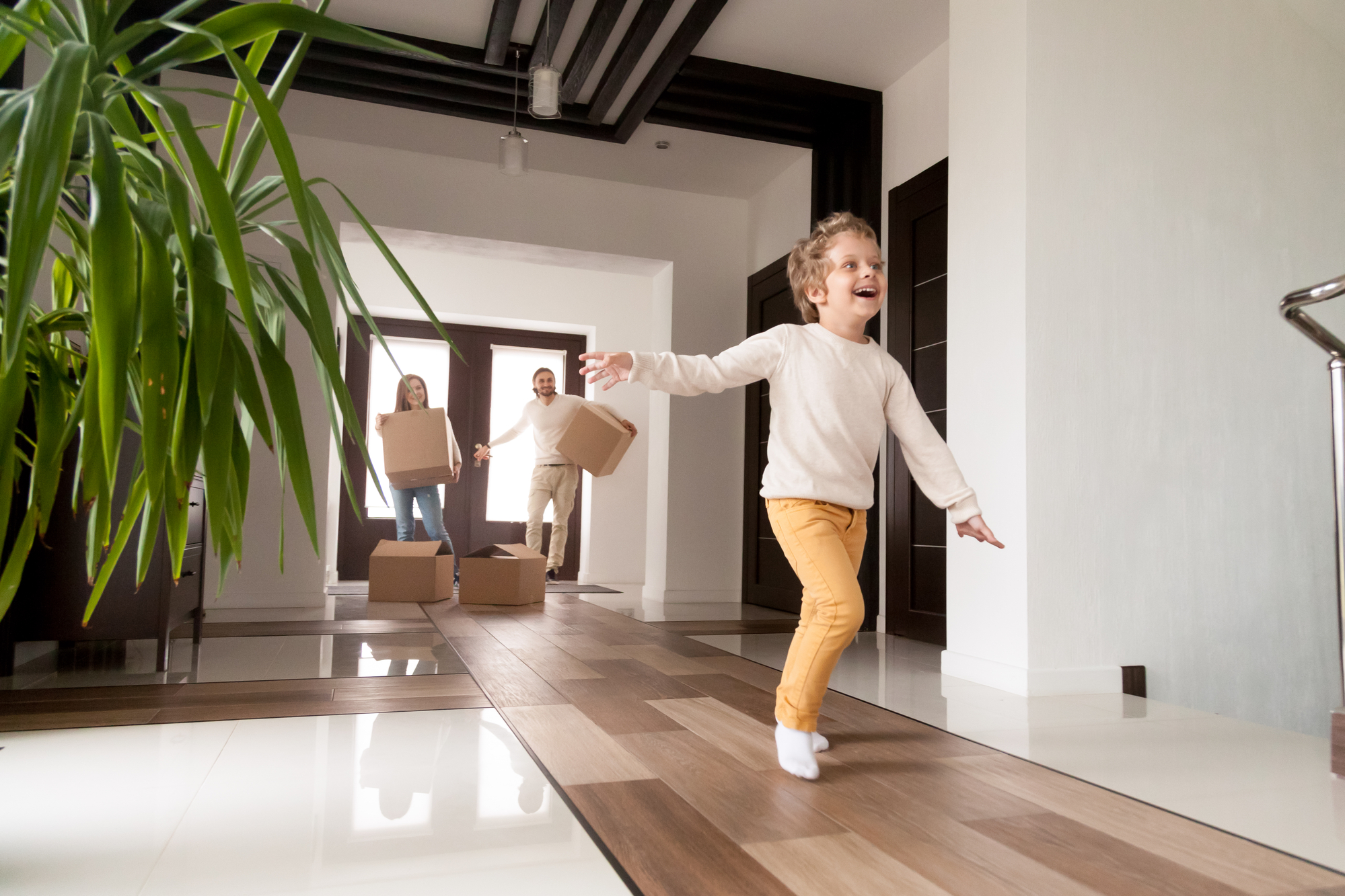 Happy family with little son arrived at their new house