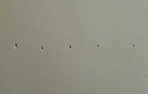 nail holes on wall