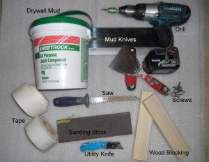 tools for fixing holes in a wall