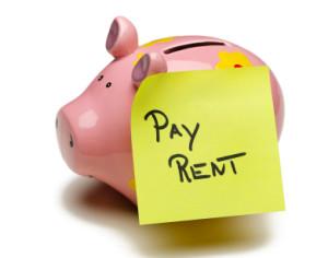 pay rent sticky note on piggy bank