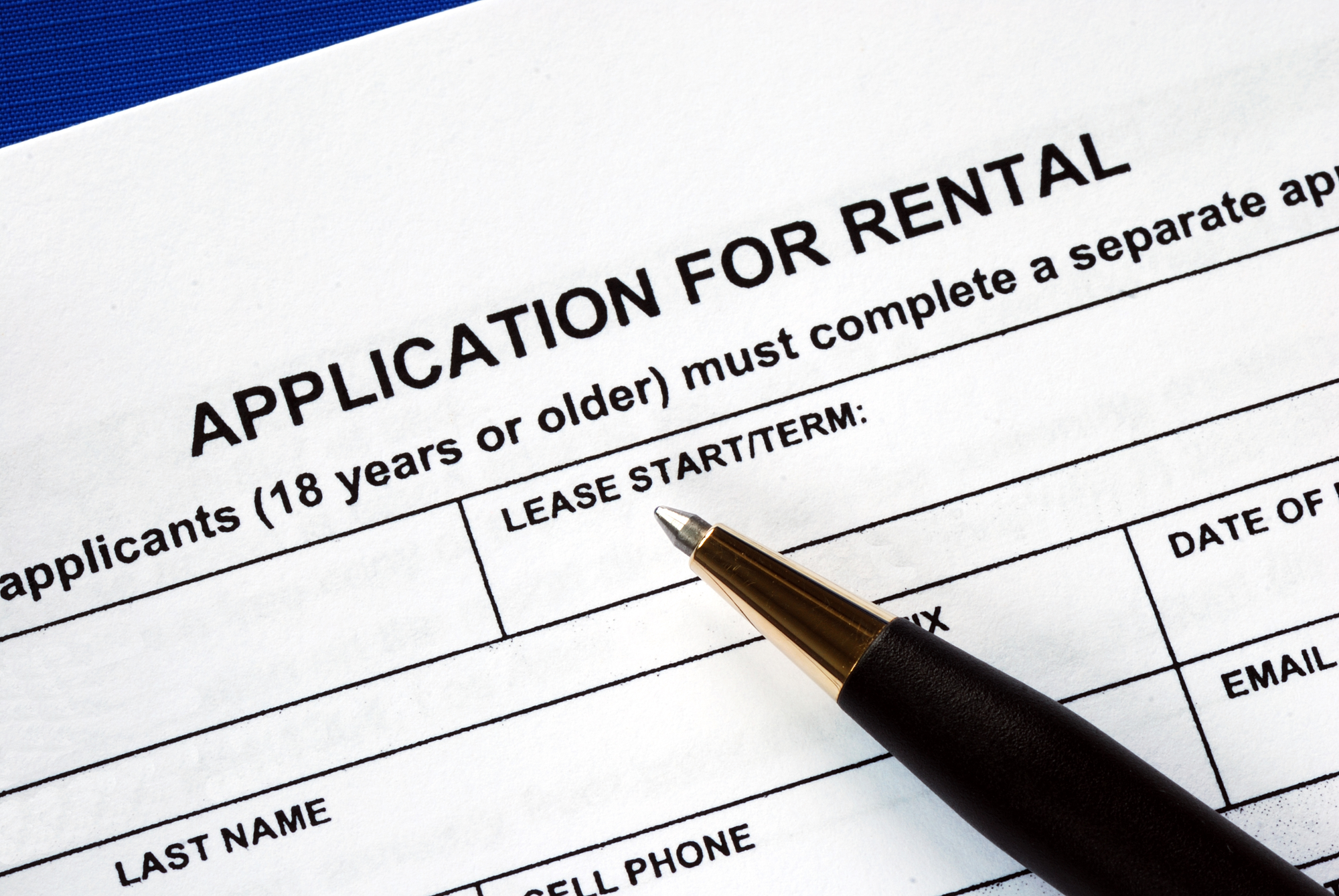Photo of a rental application and pen.