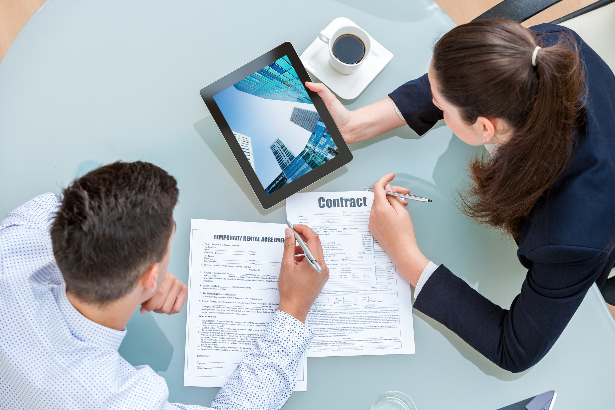 Young business couple discussing rental agreement